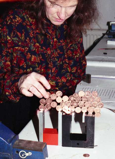 experimenting stacking coins vertically on magnets - robin linhope willson