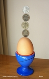 image 1943 US penny coins balancing on an egg -  robin linhope willson